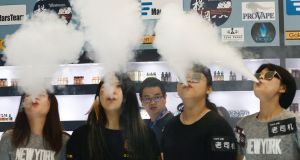 E-cigarette users at a vaping expo in China. E-cigarette vapour contains two previously undiscovered toxic chemicals, according to a new study. File photograph: Rolex Dela Pena/EPA
