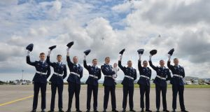Niall Dungan, Paul Chaloner, Anthony Candon, Joseph Ward, Christopher Jevens with his seven-month-old daughter Robyn,  Tadhg Firman, Colm Keena, Colm Dowling and Jamie Bray of the 32nd Air Corps Cadet Class celebrate receiving their wings and commissioning at Casement Aerodrome. Photograph: Alan Betson/The Irish Times