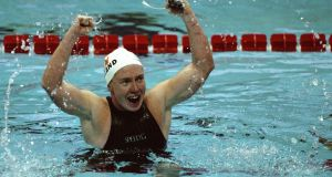 Michelle Smith celebrates her win in the women's individual 400m medley at the Georgia Tech Aquatic Centre at the 1996 Olympic Games in Atlanta, Georgia. Photograph: Michael Cooper/Allsport