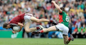 Westmeath's Kevin Maguire collides with Seamus O'Shea of Mayo during the  All-Ireland SFC Round 4B Qualifier at Croke Park. Photograph:  Donall Farmer/Inpho