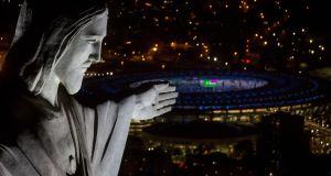 The Maracana stadium in Rio de Janeiro, overlooked by the Christ the Redeemer statue. Photograph: Chris McGrath/Getty Images