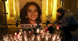 Candles are lit  at the vigil at Eyre Square in Galway to mark the first anniversary of the death of Savita Halappanavar. Photograph: Joe O'Shaughnessy.