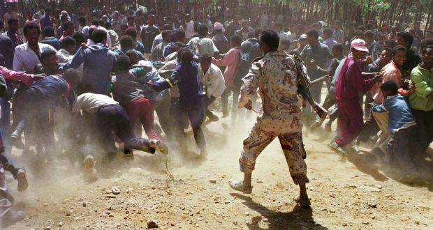 An Eritrean soldier beats back a crowd of Ethiopian detainees at a camp in Sheketi, Eritrea in June 2000. The  two-year war brought about a disastrous loss of life – 70,000-100,000 people are estimated to have died in scenes of modern trench warfare. Photograph: Tyler Hicks/Liaison