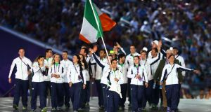 Katie Taylor leads the Ireland team into the stadium during the opening ceremony for the Baku 2015 European Games  in  Azerbaijan. Photo: Francois Nel/Getty Images