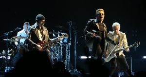 Larry Mullen Jr, The Edge, Bono and Adam Clayton of U2 performing at  the band's sold-out gig at the SSE Arena in Belfast last November. Photograph: Niall Carson/PA Wire