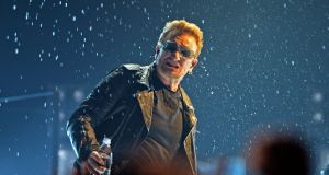 Bono sprays the audience with water  at the SSE Arena, Belfast  last November.   Photograph: Eric Luke/The Irish Times
