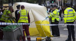 Police officers and cleaners tend to the scene of a knife attack in Russell Square on August 4th, 2016 in London, England. Photograph: Jack Taylor/Getty Images