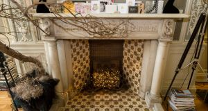 A restored fireplace in  Umit Kutluk's studion on Merrion Square, in Dublin. Photograph: Dara Mac Dónaill