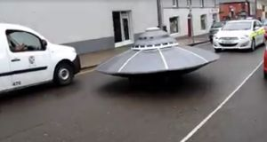 A 'UFO' is closely followed by a Garda car over the weekend in Gorey, Co Wexford. Photograph: Ali Kemal Ali/Facebook