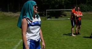Sarah Fetterlya a  Munich player  protects herself from the sun. All photographs: Cyril Byrne