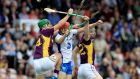 Waterford's Tadhg de Búrca (centre) excelled in the sweeper role for Waterford against Wexford in the All-Ireland quarter-final at Semple Stadium last month. Photograph: Donall Farmer.