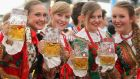 Four Polish women embrace the spirit of the occasion at Oktoberfest, Munich, Germany. Photograph: Johannes Simon/Getty Images