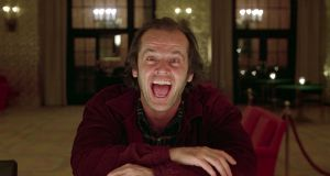 Here's Johnny! Jack Nicholson gets in the mood for the famous axe scene in 'The Shining'