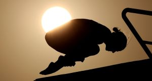 A diver during a training session as the sun sets ahead of the Rio Olympic Games, Brazil. Photograph: Mike Egerton / PA