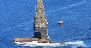 Seaside adventures: a boat off Loop Head peninsula in Co Clare