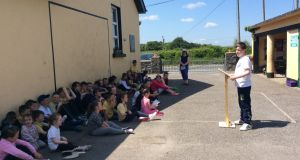 A student leads assembly on a sunny morning at the Eglish National School, Co Galway