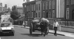 Moving hay down the North Circular Road, Dublin, 1969. Photograph:   Nutan