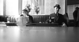 Men relaxing in a Dublin pub, 1969. Photograph: Nutan