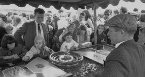 Kids spinning the wheel at the Galway races, 1969. Photograph: Nutan