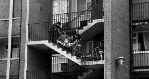 Bringing a Honda 50 down the stairs in the new flats, Dublin, 1969. Photograph: Nutan