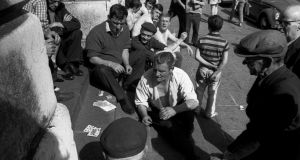 Playing Cards in front of Custom House, 1969. Photograph: Nutan
