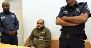Palestinian Mohammed el-Halabi, the Gaza director of World Vision, a major US-based Christian NGO, looks on during his indictment at a district court in the southern Israeli city of Beersheva. Photograph: AFP Photo