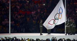 The Olympic flag is raised during the opening ceremony in Rio last night. Photograph: Ruben Sprich/Reuters