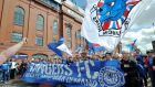 Rangers fans march to Ibrox before the match. Photo: Ian Rutherford/PA Wire