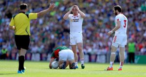 Tyrone's Sean Cavanagh is sent off for a challenge on Mayo's Aidan O'Shea (second yellow). Photo: Donall Farmer/Inpho