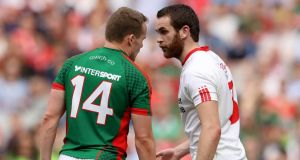 Tyrone's Cathal McShane and Andy Moran of Mayo. Photo: Ryan Byrne/Inpho