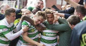 Scott Sinclair (right) celebrates his winning goal for Celtic in the the Scottish Premiership match against Hearts at Tynecastle. Photograph: Steve Welsh/Getty Images