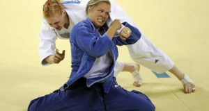 Ronda Rousey of the US (in blue) won bronze in women's 70kg judo at the 2008 Beijing Olympics and subsequently had to live in her car as she could not afford to play rent. Photograph: Olivier Morin/Getty Images.