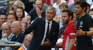 Manchester United manager Jose Mourinho explains to Juan Mata why he was taking him off in stoppage time after he came on as a substitute in the Community Shield win over Leicester City at Wembley. Photograph: Ian Kington/AFP/Getty Images