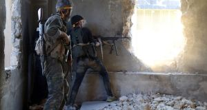 Insurgent  fighters fire towards positions of regime forces in Ramousah on the southwestern edges of Syria's northern city of Aleppo on Saturday. Photograph: Fadi Aa-Halabi/AFP/Getty Images