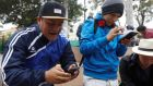 Pokémon Go players in Parque Kennedy in the Peruvian capital, Lima. Photograph: Guadalupe Pardo/Reuters