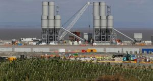 Men work at the Hinkley Point C nuclear power station site near Bridgwater in Britain, on August 4th. Photograph: Darren Staples/Reuters