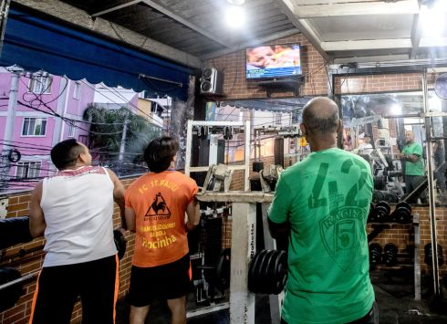 Residents of the Rocinha Favela watch the Olympics as Rafaela Silva, who grew up in Rio's City of God Favela wins a gold medal.  Photograph: James Crombie/Inpho