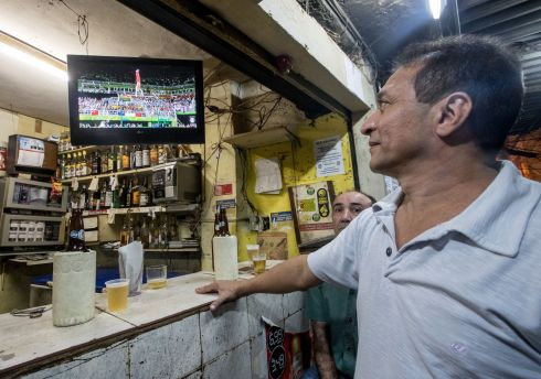 Residents of the Rocinha Favela watch the Olympics. Photograph: James Crombie/Inpho
