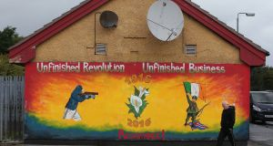 A man walks past a newly painted Republican mural commemorating the 1916 Easter Rising in the Creggan area of Derry. Photograph: Brian Lawless/PA Wire