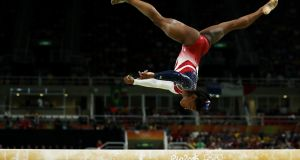 Simone Biles of the United States competes on the balance beam during the Artistic Gymnastics Women's Team Final  in Rio de Janeiro. Photograph: Lars Baron/Getty Images
