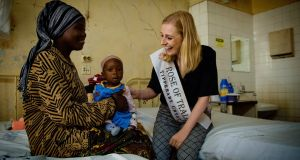 Elysha Brennan, Rose of Tralee and RCSI medical student, meets a mother and her baby during her whistle-stop tour of Irish-supported medical work in Tanzania.