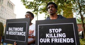 Activists gather to remember Freddie Gray and all victims of police violence during a rally outside city hall in Baltimore, Maryland. Photograph: Bryan Woolston/Reuters