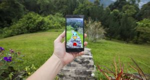 "'Pokémon Go is part of an emerging generation of ""augmented reality"" apps, which allow players to look through the camera on their phone and see a game superimposed on to the world around them.' Photograph: Getty Images"
