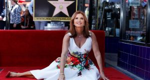 Actress Roma Downey poses on her star after it was unveiled on the Hollywood Walk of Fame in Los Angeles, California Photograph: Mario Anzuoni/Reuters