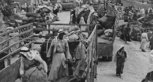 Arabs leaving the Al-Faluja pocket for Arab territory after the 1949 armistice between Israel and Egypt. Photograph: Keystone/Getty Images