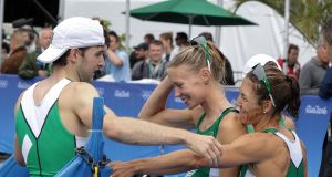Ireland's Paul O'Donovan is congratulated by Claire Lambe and Sinead Lynch after the race. Photo: Morgan Treacy/Inpho
