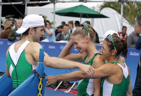 Ireland's Paul O'Donovan is congratulated by Claire Lambe and Sinead Lynch after the race. Photograph: Morgan Treacy/Inpho