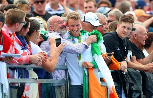 Ireland's Gary O'Donovan celebrates winning with his father Teddy. Photograph: James Crombie/Inpho