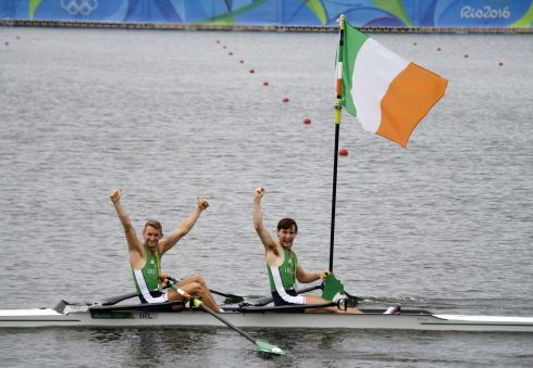 Gary O'Donovan and Paul O'Donovan enjoying their achievement. Photograph: Damien Meyer/AFP/Getty Images