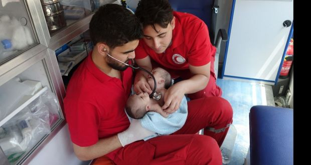 Doctors seek help after conjoined twins born in Syria war zone